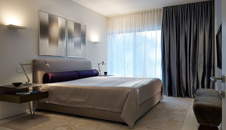 Large and thick curtains to a great extent can make rooms look occupied